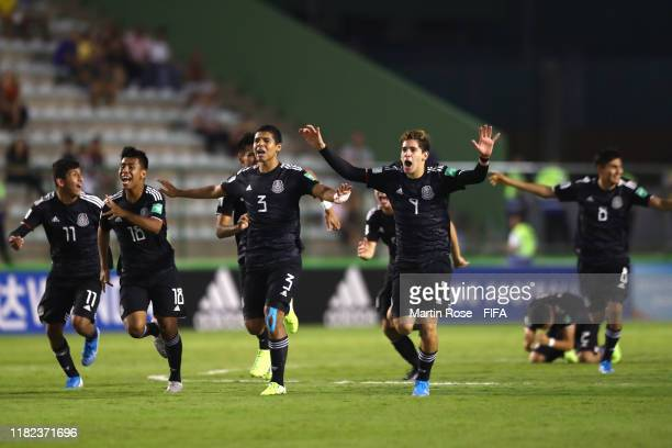 The Mexico players celebrate their victory in a penalty shootout during the FIFA U17 World Cup Brazil 2019 semifinal match between Mexico and the...