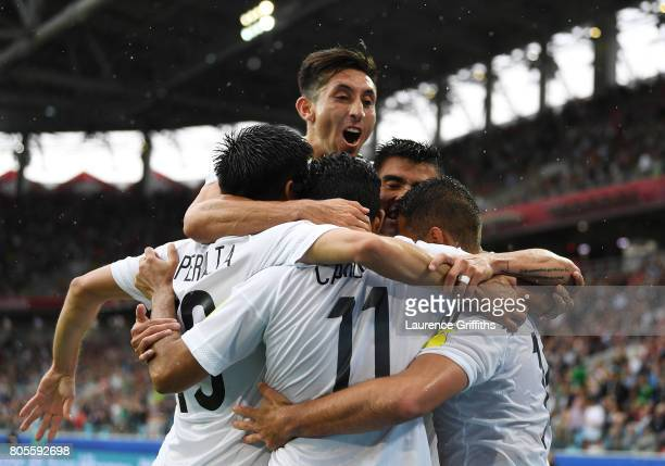 The Mexico team celebrate their first goal during the FIFA Confederations Cup Russia 2017 PlayOff for Third Place between Portugal and Mexico at...