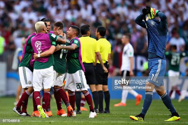 The Mexico team celebrate victory as Manuel Neuer of Germany looks dejected after the 2018 FIFA World Cup Russia group F match between Germany and...