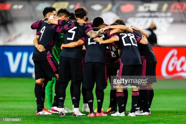 The Mexico team huddle together before the game between Mexico and Iceland on May 29, 2021 at AT&T Stadium in Arlington, Texas.