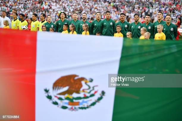 The Mexico team line up for national anthem behind the Mexico flag prior to the 2018 FIFA World Cup Russia group F match between Germany and Mexico...
