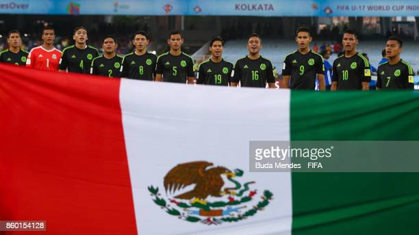 The Mexico team lines up for the National Anthems ahead the FIFA U17 World Cup India 2017 group F match between England and Mexico at Vivekananda...