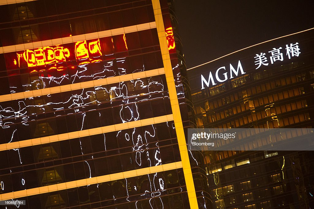 The MGM Macau casino resort, operated by MGM China Holdings Ltd., right, stands in Macau, China, on Wednesday, Feb. 6, 2013. Casino industry revenue in the gambling hub climbed 14 percent to a record 304 billion patacas ($38 billion) last year. Photographer: Lam Yik Fei/Bloomberg via Getty Images