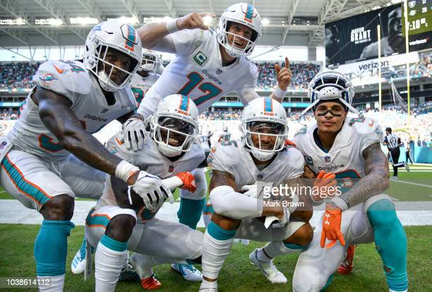 The Miami Dolphins celebrate after scoring a touchdown during the fourth quarter against the Oakland Raiders at Hard Rock Stadium on September 23...