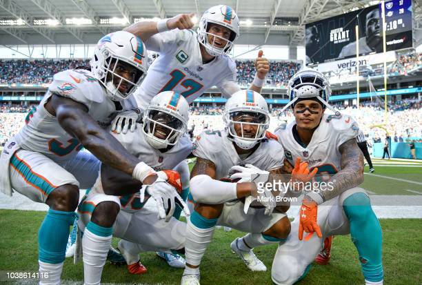 The Miami Dolphins celebrate after scoring a touchdown during the fourth quarter against the Oakland Raiders at Hard Rock Stadium on September 23,...