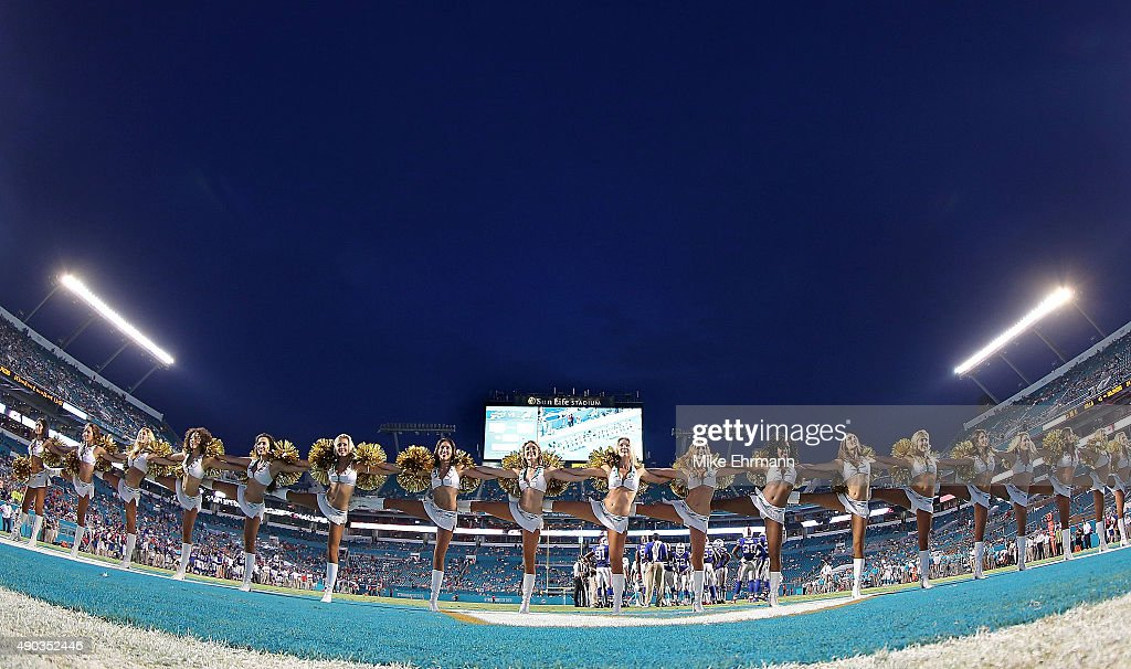 The Miami Dolphins cheerleaders perform during a game against the Buffalo Bills at Sun Life Stadium on September 27, 2015 in Miami Gardens, Florida.