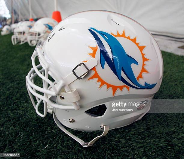 The Miami Dolphins new logo is displayed on a helmet during rookie camp on May 3 2013 at the Miami Dolphins training facility in Davie Florida