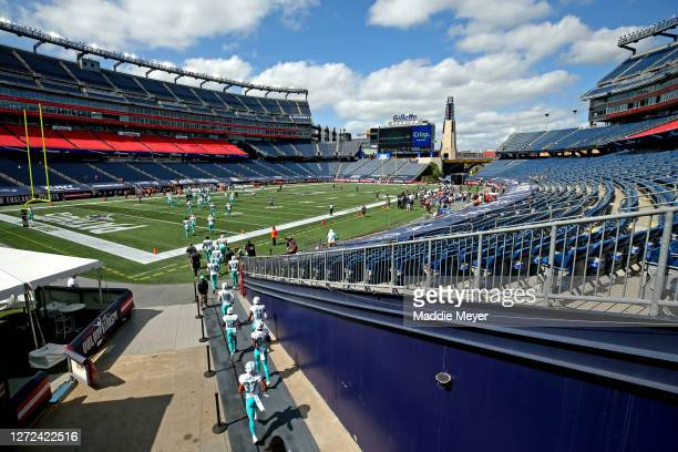The Miami Dolphins take the field before their game against the New England Patriots at Gillette Stadium on September 13, 2020 in Foxborough,...
