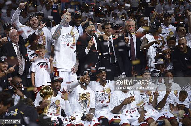 The Miami Heat and staff celebrate winning Game 7 of the NBA Finals over the San Antonio Spurs at the American Airlines Arena June 20 2013 in Miami...