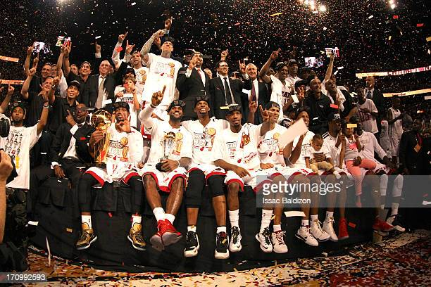 The Miami Heat and their coaches and staff pose for a photo to celebrate their championship victory during Game Seven of the 2013 NBA Finals against...