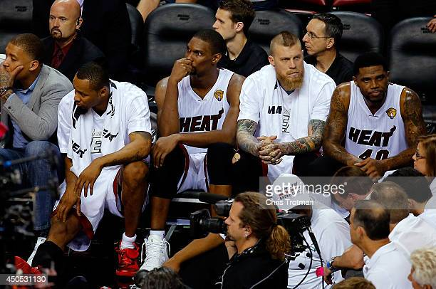 The Miami Heat bench looks on against the San Antonio Spurs during Game Four of the 2014 NBA Finals at American Airlines Arena on June 12 2014 in...