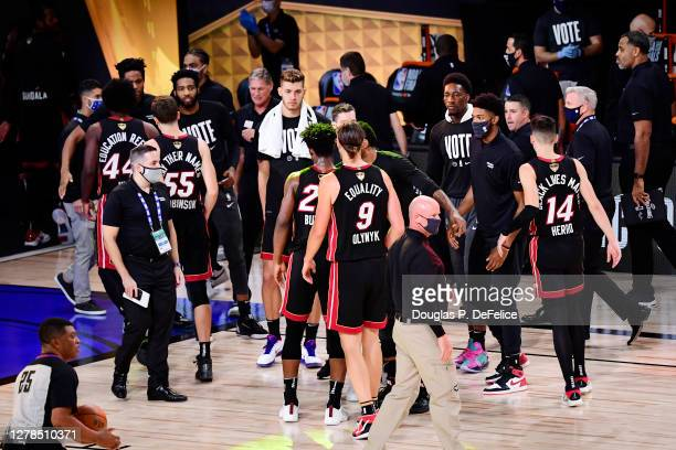 The Miami Heat celebrate after defeating the Los Angeles Lakers 115-104 in Game Three of the 2020 NBA Finals at AdventHealth Arena at ESPN Wide World...