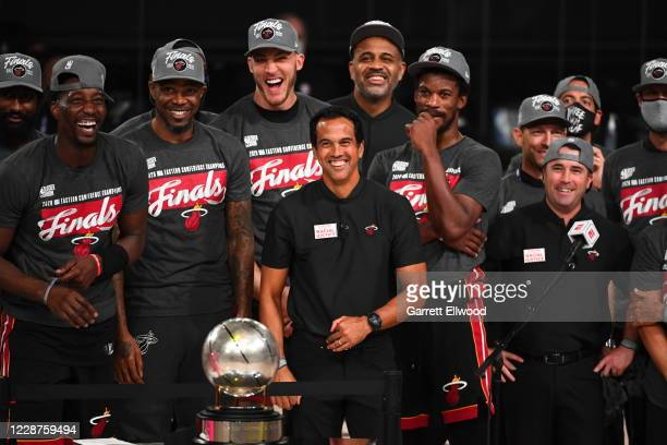 The Miami Heat celebrate after winning Game Six of the Eastern Conference Finals against the Boston Celtics on September 27, 2020 in Orlando, Florida...