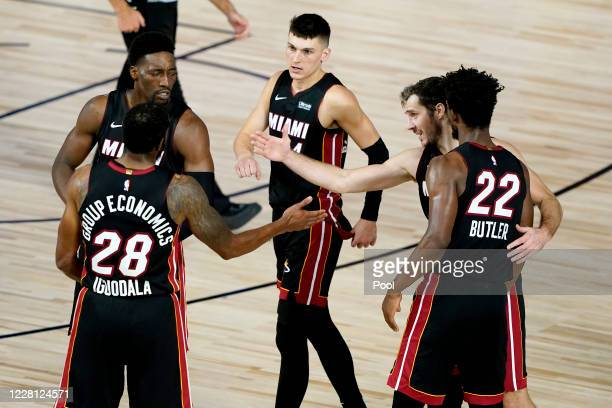 The Miami Heat celebrate their win against the Indiana Pacers in Game Two during the first round of the NBA playoffs at The Field House at ESPN Wide...