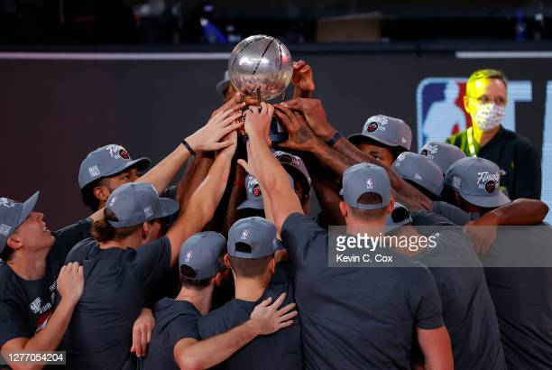 The Miami Heat celebrate with the trophy after they are Eastern Finals Champions against the Boston Celtics in Game Six of the Eastern Conference...
