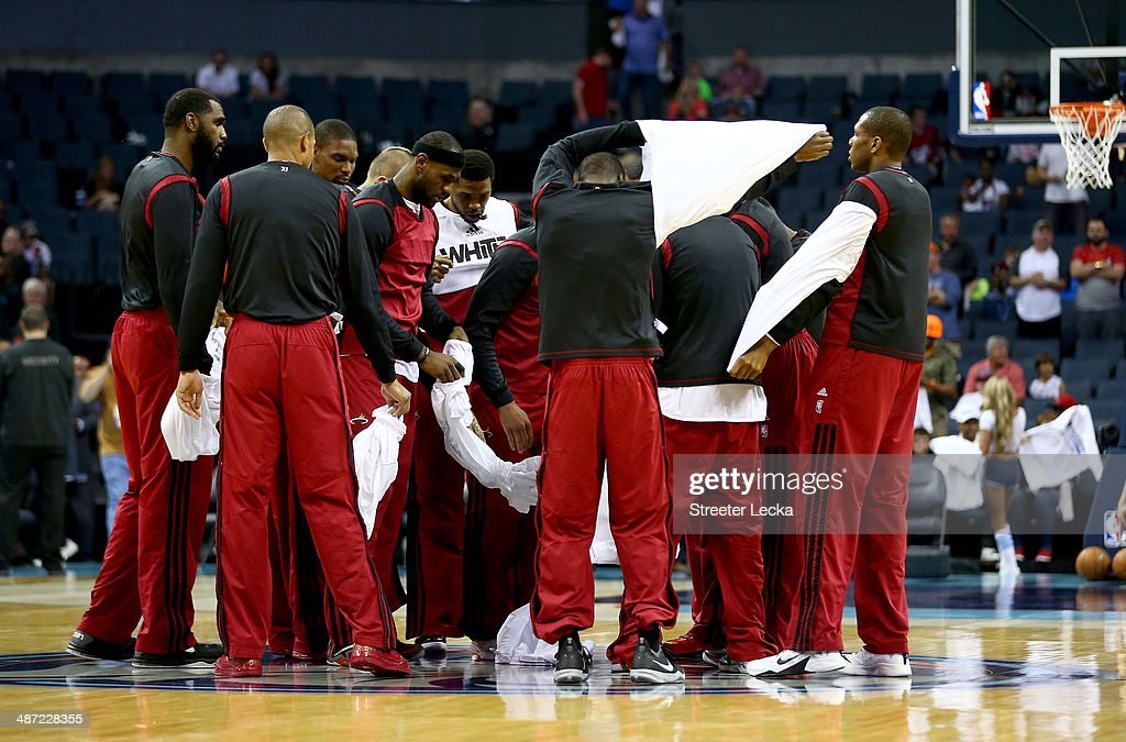 The Miami Heat huddle at center court as they take off their warm up jerseys before their game against the Charlotte Bobcats in Game Four of the Eastern Conference Quarterfinals during the 2014 NBA Playoffs at Time Warner Cable Arena on April 28, 2014 in Charlotte, North Carolina.