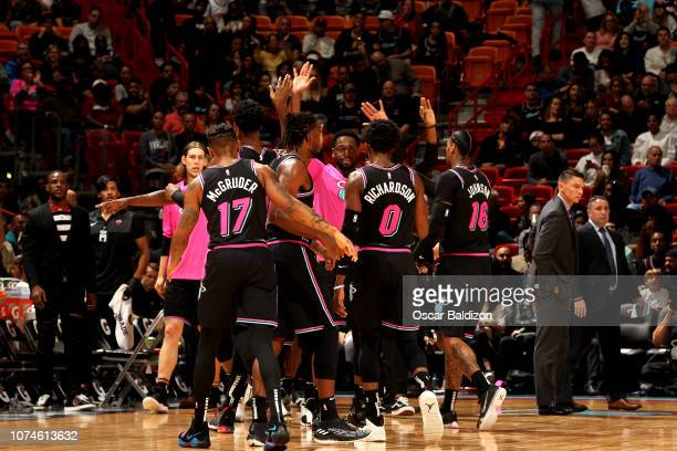 The Miami Heat hudldes up against the Miami Heat on December 22 2018 at American Airlines Arena in Miami Florida NOTE TO USER User expressly...