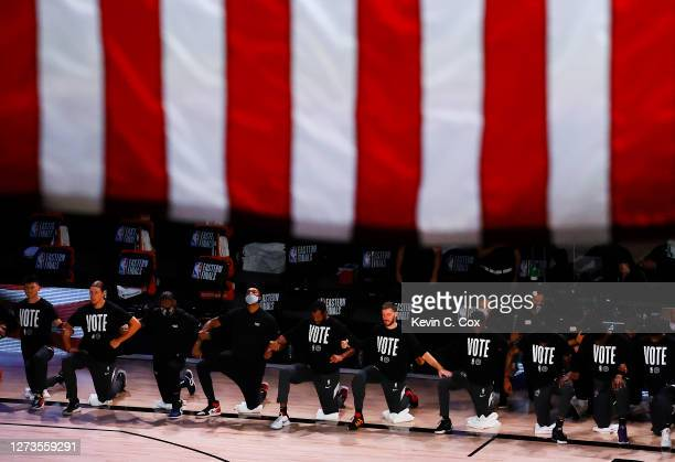 The Miami Heat kneel during the National Anthem prior to the start of the game against the Boston Celtics in Game Three of the Eastern Conference...