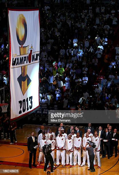 The Miami Heat raise the 2013 Championship Banner during a game against the Chicago Bulls at American Airlines Arena on October 29 2013 in Miami...