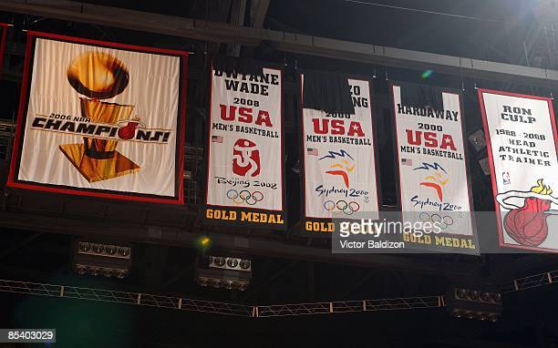 The Miami Heat reveal commemorative banners to honor gold medalists Dwyane Wade Alonzo Mourning and Tim Hardaway during the halftime ceremony in the...