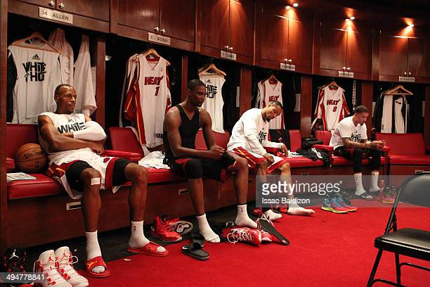 The Miami Heat sit in the locker room before Game Six of the Eastern Conference Finals against the Indiana Pacers during the 2014 NBA Playoffs on May...