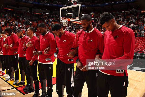 The Miami Heat stand for a moment of silence for the National Anthem before the game against the Houston Rockets on January 17 2017 at...