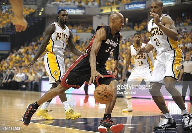The Miami Heat's Allen drives against the Indiana Pacers' David West during the first half in Game 5 of the Eastern Conference finals at Bankers Life...