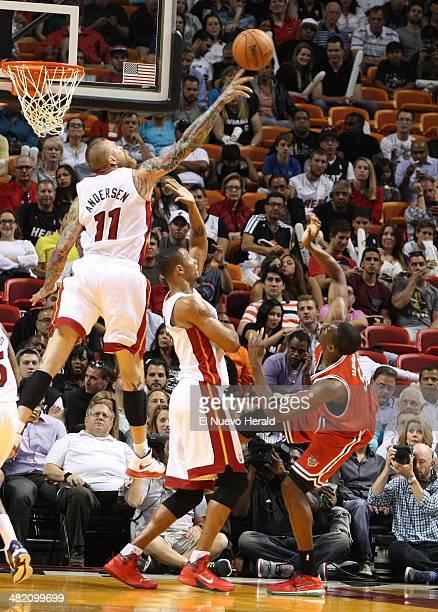 The Miami Heat's Chris Andersen left blocks the shot of the Milwaukee Bucks' Ekpe Udoh in the second quarter at the American Airlines Arena in Miami...
