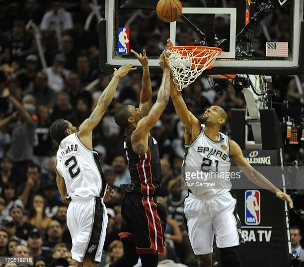 The Miami Heat's Chris Bosh middle has his shot blcked by Tim Duncan of the San Antonio Spurs during the third quarter of Game 4 of the NBA Finals at...
