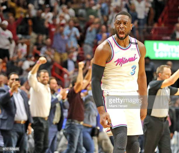 The Miami Heat's Dwyane Wade celebrates with the crowd after scoring the winning basket in the final seconds against the Philadelphia 76ers at the...