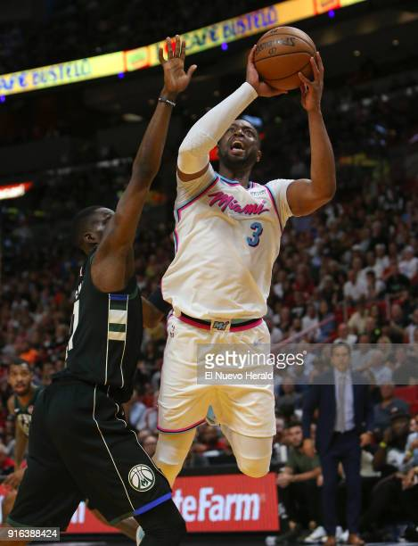 The Miami Heat's Dwyane Wade goes to the basket against the Milwaukee Bucks' Tony Snell during the second quarter at the AmericanAirlines Arena in...