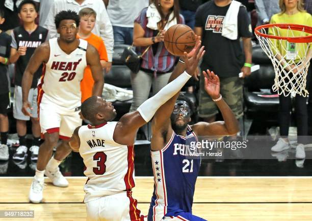 The Miami Heat's Dwyane Wade has his shot blocked by the Philadelphia 76ers' Joel Embiid late in the fourth quarter in Game 4 of the firstround NBA...
