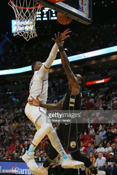 The Miami Heat's Dwyane Wade left blocks a shot by the Milwaukee Bucks' Eric Bledsoe during the fourth quarter at the AmericanAirlines Arena in Miami...