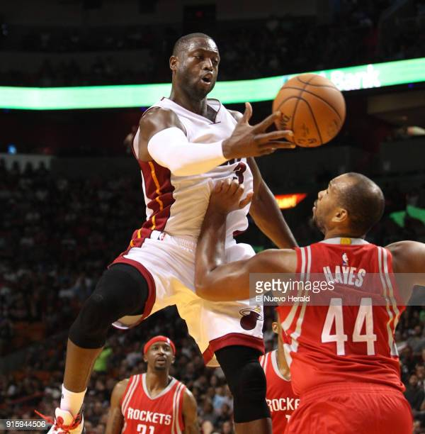The Miami Heat's Dwyane Wade makes a pass over the Houston Rockets' Chuck Hayes on November 1 at AmericanAirlines Arena in Miami