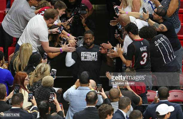 The Miami Heat's Dwyane Wade middle runs into the court before the start of action against the Milwaukee Bucks at the AmericanAirlines Arena in Miami...