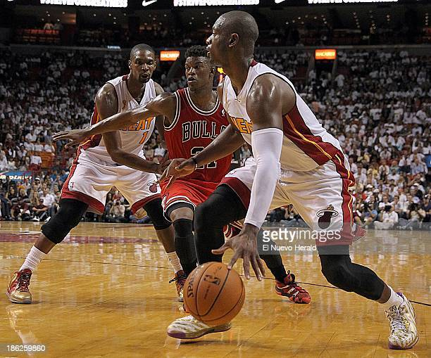 The Miami Heat's Dwyane Wade right drives against the Chicago Bulls' Jimmy Butler in the fourth quarter at AmericanAirlines Arena in Miami Florida on...