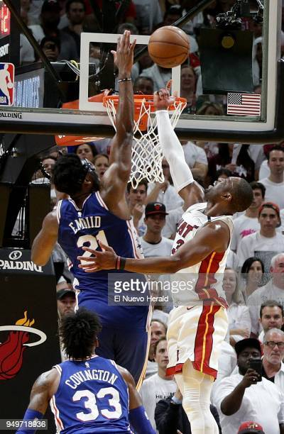 The Miami Heat's Dwyane Wade right has his shot blocked at the basket by the Philadelphia 76ers' Joel Embiid in the fourth quarter in Game 4 of the...