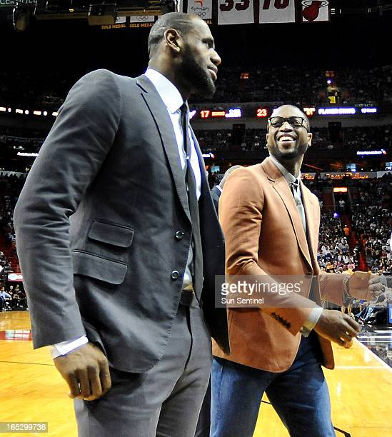 dde64f4f6678 The Miami Heat s Dwyane Wade right laughs during a timeout with teammate LeBron  James during a