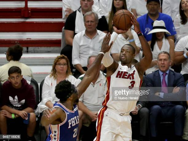 The Miami Heat's Dwyane Wade shoots against the Philadelphia 76ers' Joel Embiid in the first quarter in Game 4 of the firstround NBA Playoff series...