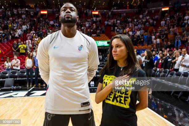 The Miami Heat's Dwyane Wade stands next to Andrea Ghersi the sister of Joaquin Oliver who was killed in the Marjory Stoneman Douglas High School...