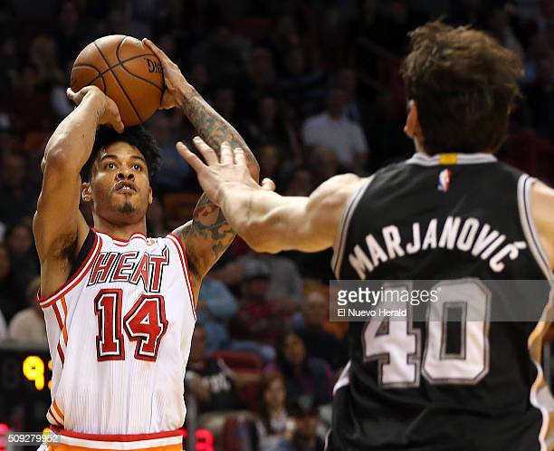 The Miami Heat's Gerald Green shoots a 3-pointer over the San Antonio Spurs' Boban Marjanovic in the fourth quarter at AmericanAirlines Arena in...
