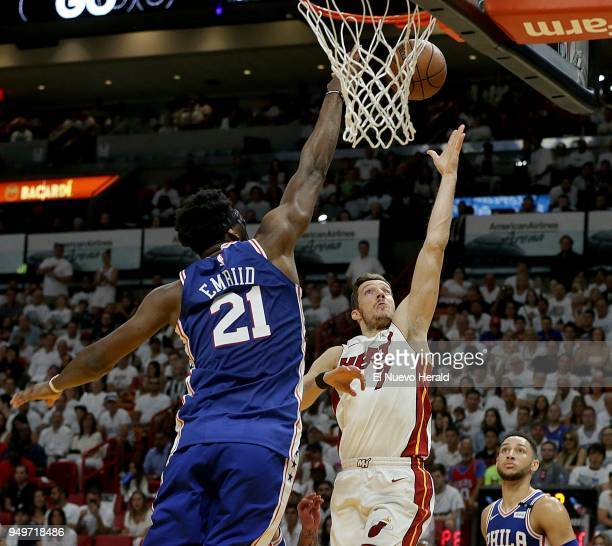 The Miami Heat's Goran Dragic goes to the basket against the Philadelphia 76ers' Joel Embiid in the second quarter in Game 4 of the firstround NBA...
