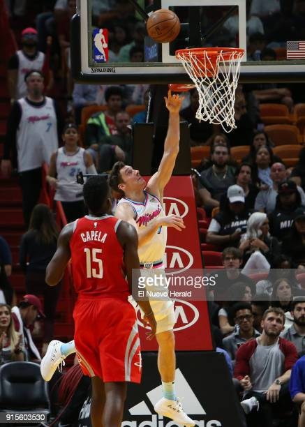 The Miami Heat's Goran Dragic goes to the basket against the Houston Rockets' Clint Capela during the fourth quarter at the AmericanAirlines Arena in...