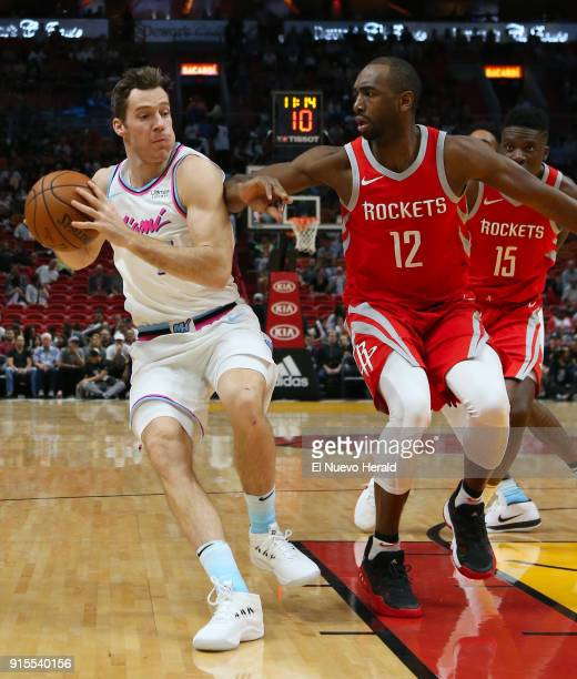 The Miami Heat's Goran Dragic left drives against the Houston Rockets' Luc Mbah a Moute during the first quarter at the AmericanAirlines Arena in...