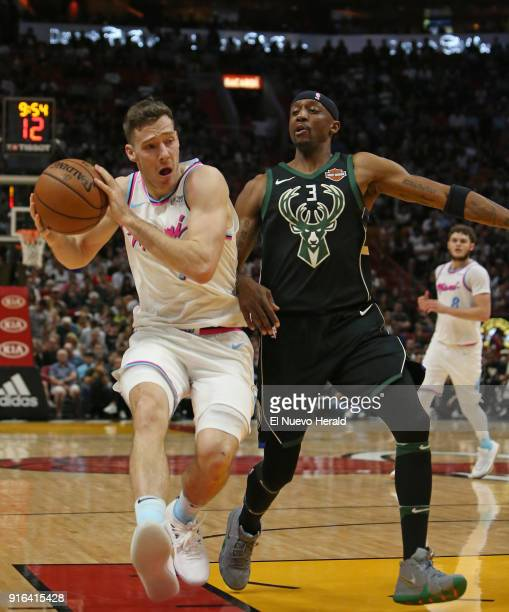 The Miami Heat's Goran Dragic left drives against the Milwaukee Bucks' Jason Terry during the second quarter at the AmericanAirlines Arena in Miami...