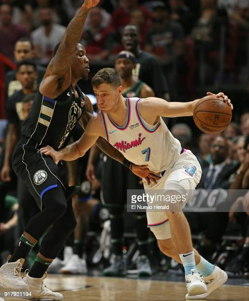 The Miami Heat's Goran Dragic right drives against the Milwaukee Bucks' Eric Bledsoe during the fourth quarter at the AmericanAirlines Arena in Miami...