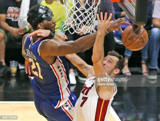 The Miami Heat's Goran Dragic right has his shot blocked by the Philadelphia 76ers' Joel Embiid late in the fourth quarter in Game 4 of the...