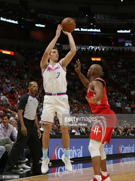 The Miami Heat's Goran Dragic shoots over the Houston Rockets' Chris Paul right during the first quarter at the AmericanAirlines Arena in Miami on...