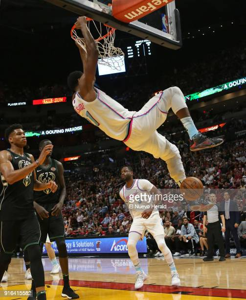 The Miami Heat's Hassan Whiteside dunks against the Milwaukee Bucks' Giannis Antetokounmpo during the second quarter at the AmericanAirlines Arena in...