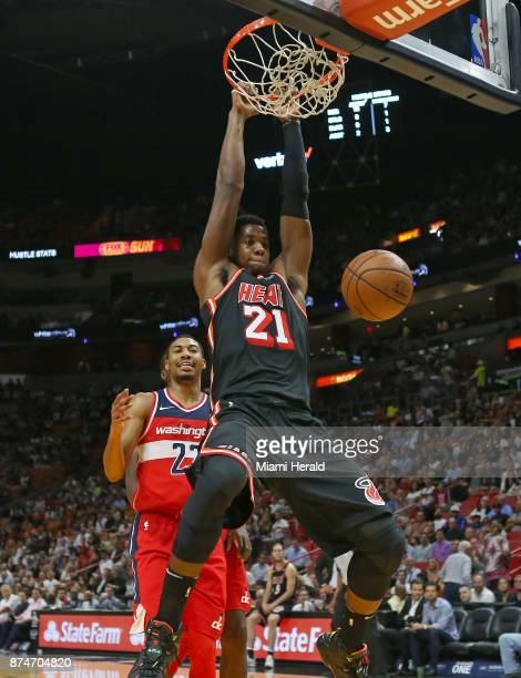 The Miami Heat's Hassan Whiteside dunks against the Washington Wizards' Otto Porter Jr during the first quarter at the AmericanAirlines Arena in...